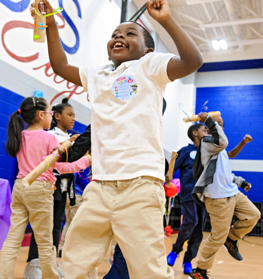 Photo - Edward Elementary second grader Cory Clemons gets active as he dances to the music during the celebration of the classes achievements for the Wiggle Out Loud activity challenge at Edward Elementary School in Oklahoma City, Okla. on Friday, March 1, 2019. Photo by Chris Landsberger, The Oklahoman