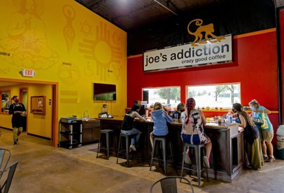Photo -  People gather for lunch at Joe's Addiction's coffeehouse and community haven at 1725 SE 59.  [Chris Landsberger/The Oklahoman]