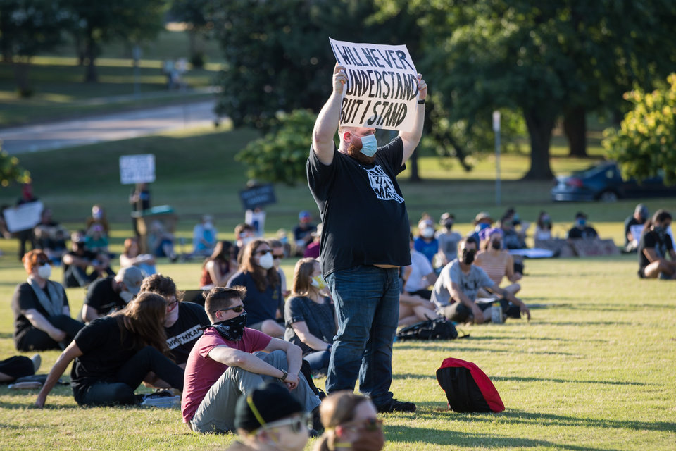 "Photo - A supporter holds up a sign during the ""Rally Against Hate"" at Veterans Park in Tulsa, OK on 6/20/20.  BRETT ROJO/For the Tulsa World"