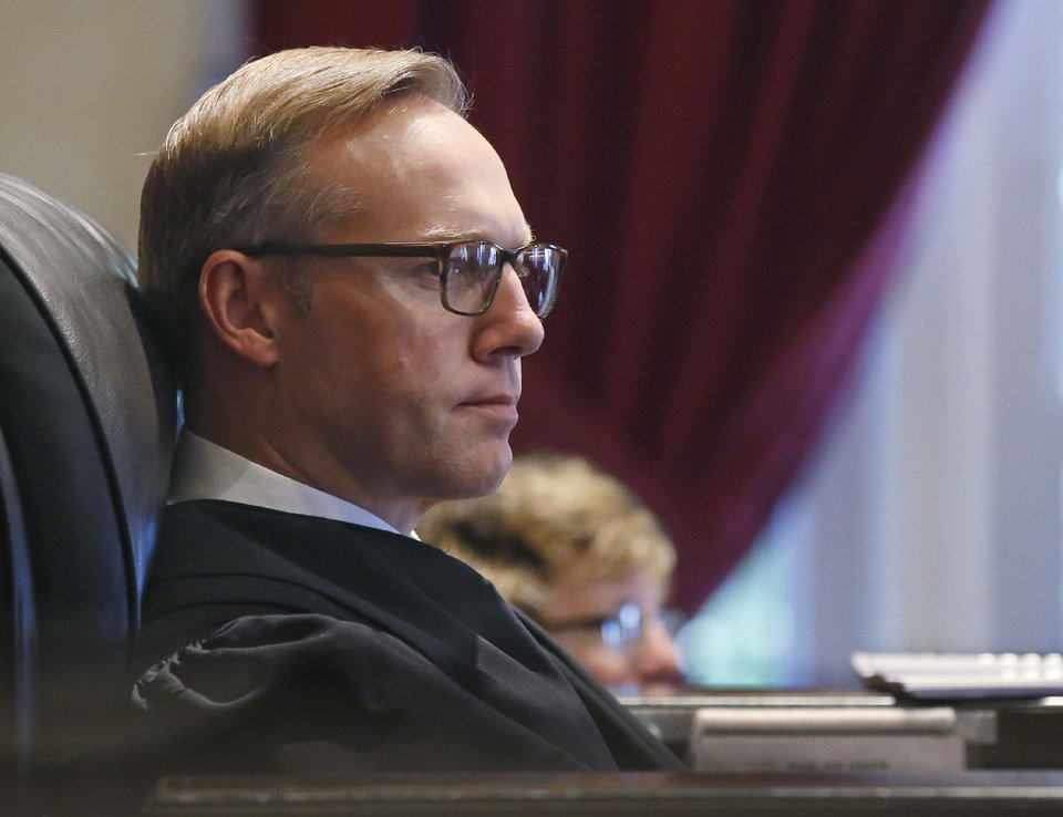 Photo -  Judge Thad Balkman listens during closing arguments in Oklahoma's ongoing opioid drug lawsuit against Johnson & Johnson Monday, July 15, 2019, in Norman. [AP Photo/Sue Ogrocki]