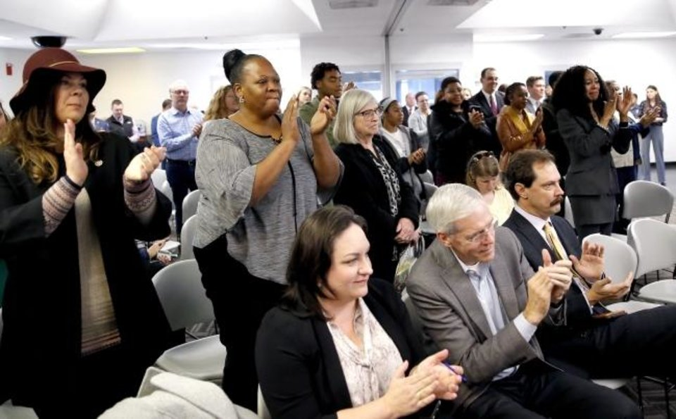Photo -  People applaud Friday at Kate Barnard Correctional Center in Oklahoma City after the Pardon and Parole Board read the names of Oklahoma inmates recommended for commutation. [Sarah Phipps/The Oklahoman]