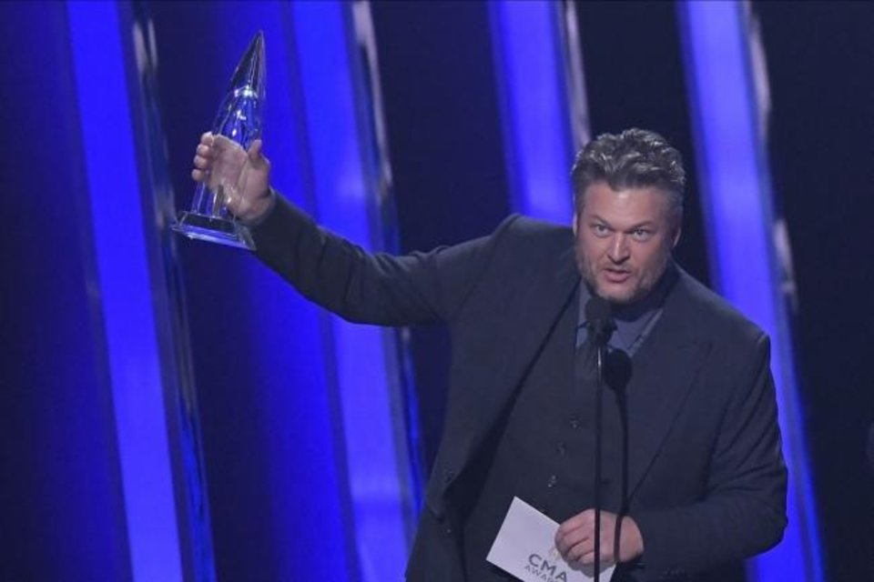 Photo -  Blake Shelton accepts the award Wednesday for single of the year for