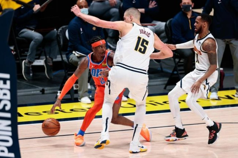 Photo -  Jan 19, 2021; Denver, Colorado, USA; Oklahoma City Thunder guard Shai Gilgeous-Alexander (2) controls the ball against Denver Nuggets center Nikola Jokic (15) and guard Monte Morris (11) in the third quarter at Ball Arena. Mandatory Credit: Isaiah J. Downing-USA TODAY Sports