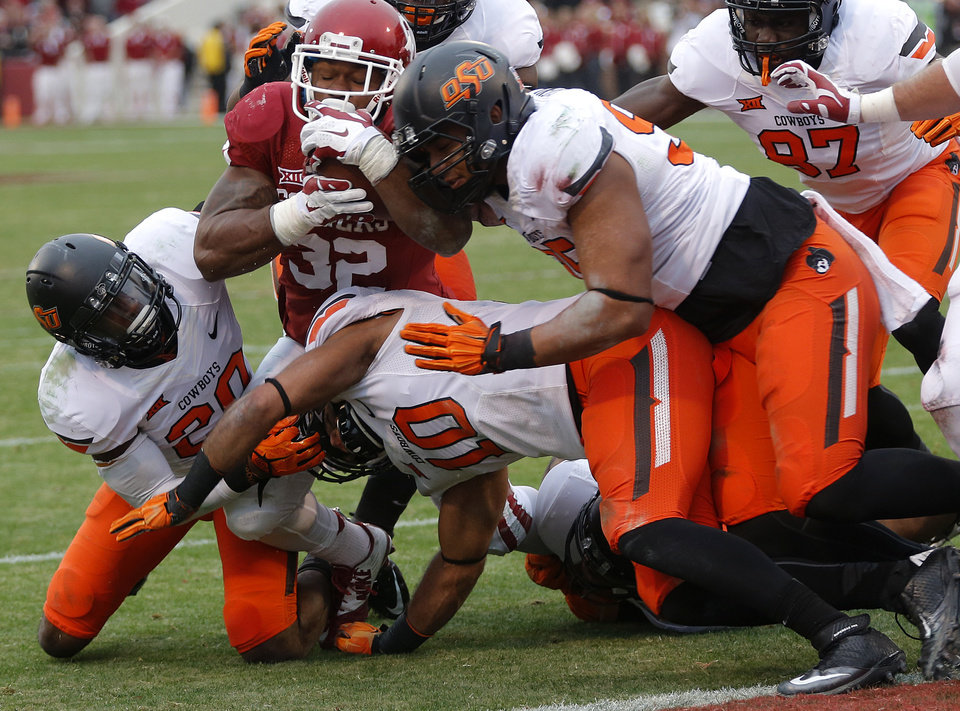 Photo - The Oklahoma State defense stops Oklahoma's Samaje Perine (32) short of the goal line during a Bedlam college football game between the University of Oklahoma Sooners (OU) and the Oklahoma State University Cowboys (OSU) at the Gaylord Family Oklahoma Memorial Stadium in Norman, Okla. on Saturday, Dec. 6, 2014. Photo by Chris Landsberger, The Oklahoman