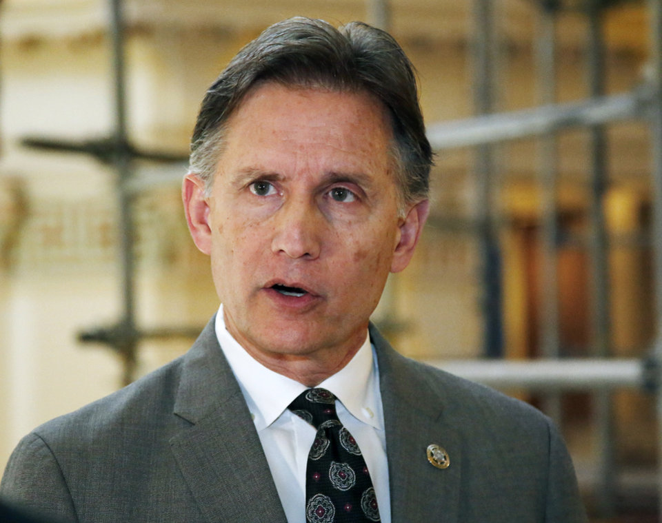 Photo -  Attorney General Mike Hunter answers questions during a news conference Monday, April 1, 2019, in Oklahoma City. A $270 million settlement between the state of Oklahoma and the maker of OxyContin received high praise last week as an innovative way to help combat opioid addiction. Hunter is now facing bipartisan backlash from Oklahoma lawmakers who say he overstepped his authority and circumvented their role. [AP PHOTO]