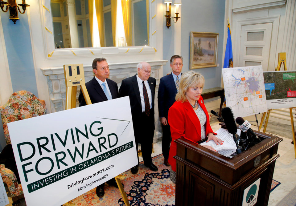 "Photo - Gov. Mary Fallin was joined in the Blue Room at the State Capitol Thursday, Oct. 29, 2015, by Secretary of Transportation Gary Ridley, and members of the Oklahoma Turnpike Authority in revealing publicly the launch of a multi-million dollar  campaign called ""Driving Forward: Investing in Oklahoma's Future,"" an extensive expansion and improvement plan that state officials promise will lay the groundwork for the future of turnpike transportation in Oklahoma. The ceremonial room near the governor's office was packed with state lawmakers, transportation officials and civic leaders from around the state, especially those representing communities and towns that will benefit  by the new roads. Behind the governor are  Oklahoma Turnpike Authority Board of Directors Chairman Kell Kelly,  state Secretary of Transportation Gary Ridley, and Oklahoma Turnpike Authority Executive Director Tim Stewart.  Photo by Jim Beckel, The Oklahoman."