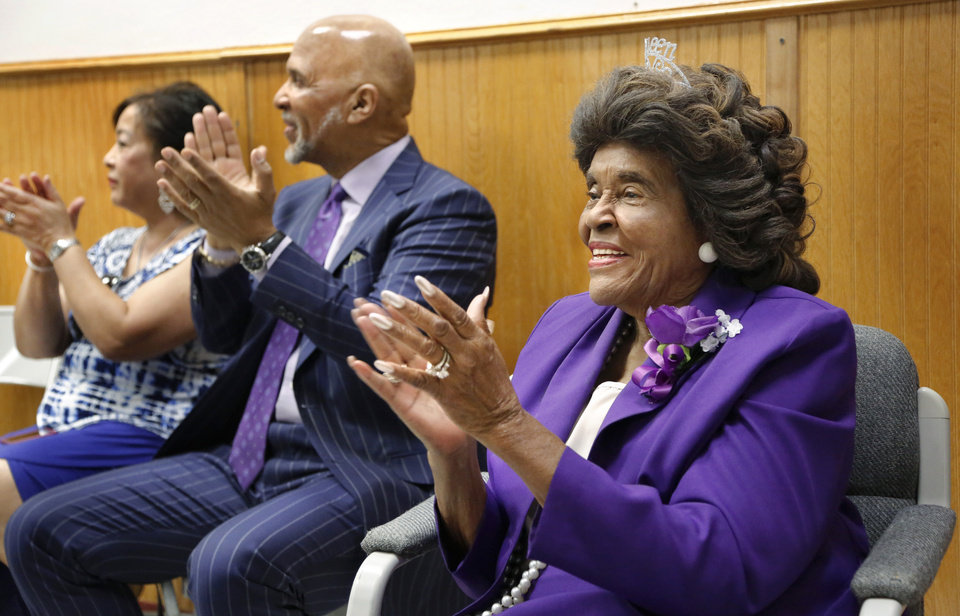 Photo - Thelma Parks, right, joins in applauding for  students and teachers during the assembly where Parks was honored. Seated beside Parks is Thurman White, Jr., and his wife, Eileen. The school that bears her name, Thelma Parks Elementary School, is celebrating its 20th anniversary with special guests that included Parks,  a former teacher and school board member, and White Jr., a 2017 Foundation for Oklahoma City Public Schools Wall of Fame inductee who had Parks as a teacher. The event was held  in the school's auditorium on Thursday, Nov. 2, 2017.  Photo by Jim Beckel, The Oklahoman