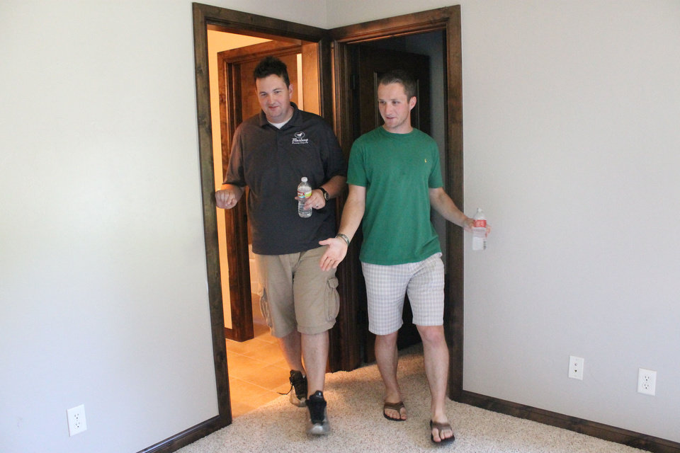 Photo - Nick Goree, 25, of Oklahoma City, takes a tour of his new house he won in the St. Jude Dream Home Giveaway Sunday.  TIFFANY GIBSON - THE OKLAHOMAN