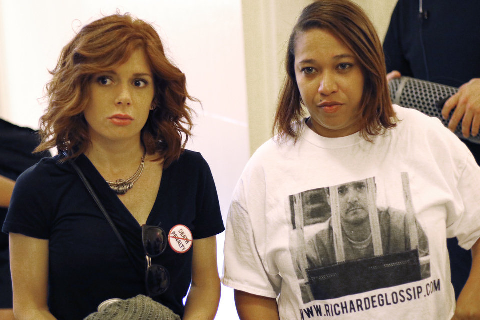 Photo - Bridgette McInroe and Erika Glossip-Hodges, Richard's daughter, outside the Governor's office after rally to try and delay the execution of Richard Glossip at the Capitol Tuesday, September 15, 2015. Photo by Doug Hoke, The Oklahoman