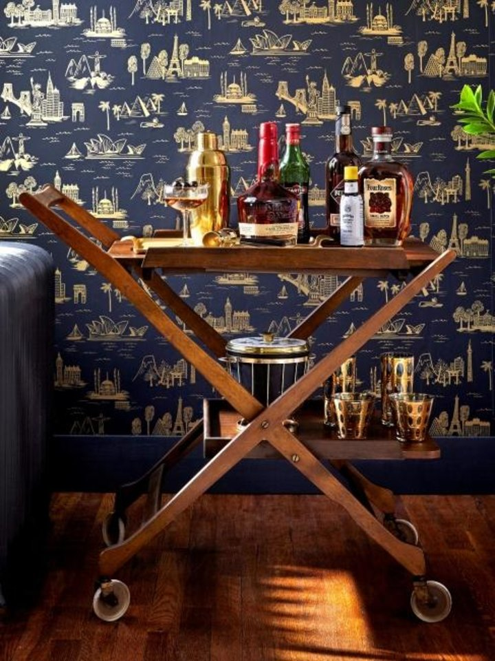 Photo -  Once a staple of golden-era films, the bar cart has returned to today's homes serving up sips for all occasions. [PHOTO PROVIDED/ANTONIS ACHILLEOS]