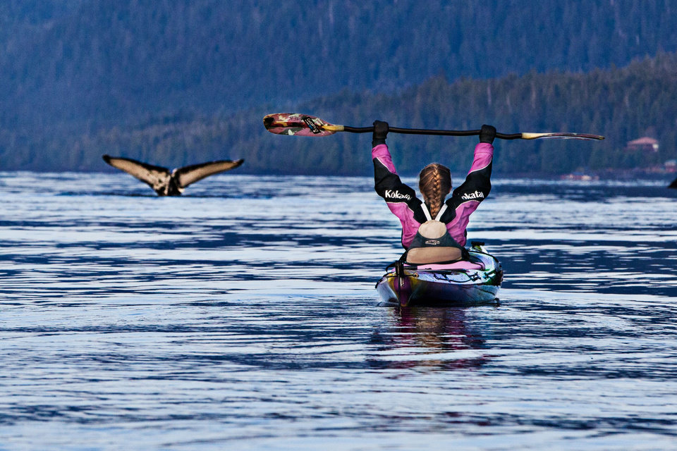 Photo - Abby Holcombe celebrates a whale sighting while kayaking near Ketchikan, Alaska. (Photo by Peter Holcombe)