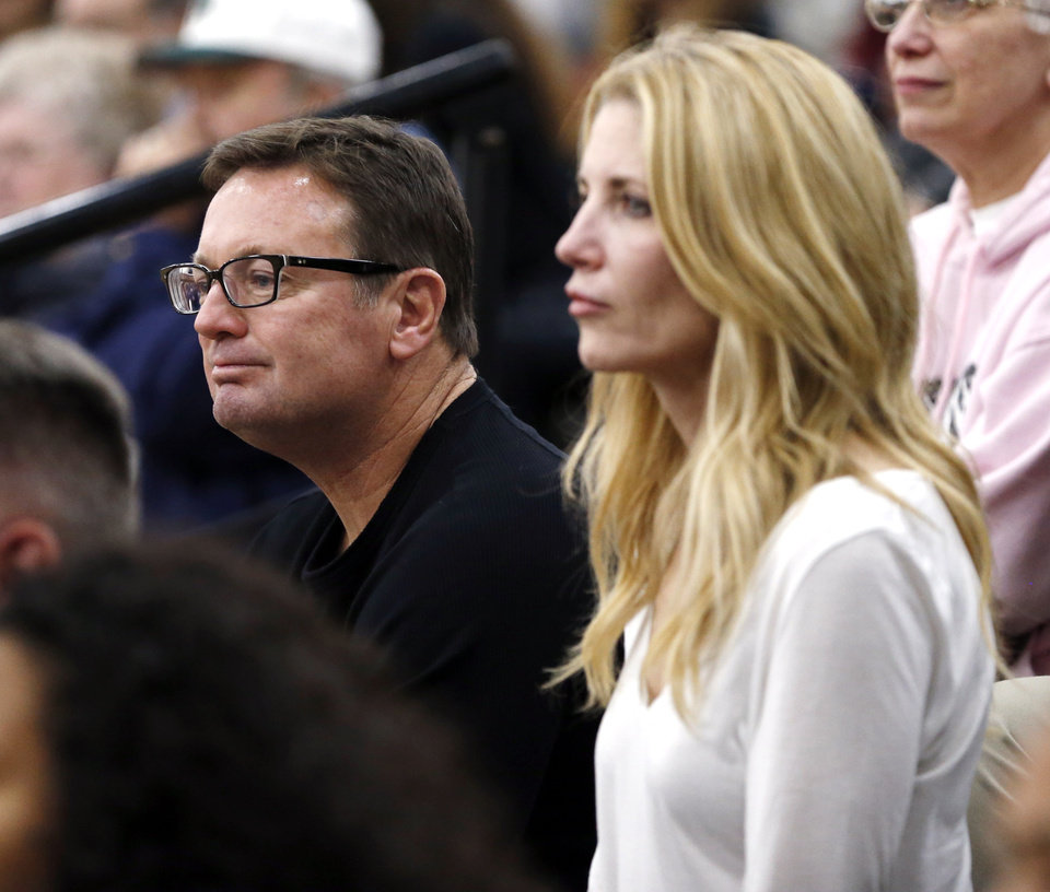 Photo - University of Oklahoma head football coach Bob Stoops and wife Carol watch Norman North boys basketball game between the Norman North Timberwolves and the Westmoore Jaguars on Tuesday, Jan. 3, 2017 in Norman, Okla. Sons Isaac and Drake are part of the team.  Photo by Steve Sisney, The Oklahoman