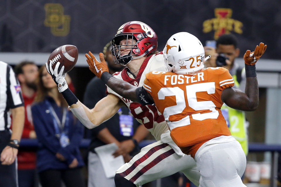 Photo - Oklahoma's Grant Calcaterra (80) catches a touchdown pass in front of B.J. Foster (25) of Texas during the Big 12 Championship football game between the Oklahoma Sooners (OU) and the Texas Longhorns (UT) at AT&T Stadium in Arlington, Texas, Saturday, Dec. 1, 2018.  Oklahoma won 39-27. Photo by Bryan Terry, The Oklahoman