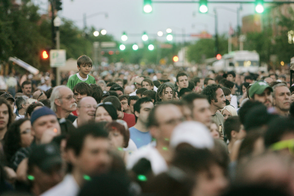Photo -  A crowd fills main street to watch the Chainsaw Kittens perform in 2008 during the first Norman Music Festival in downtown Norman. [The Oklahoman Archives]