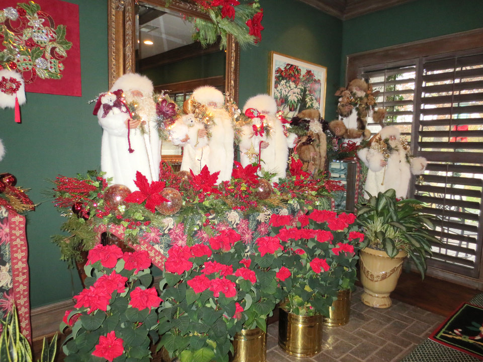 Photo - Santas at the Love home ready for a Merry Christmas. PHOTO BY HELEN FORD WALLACE, THE OKLAHOMAN