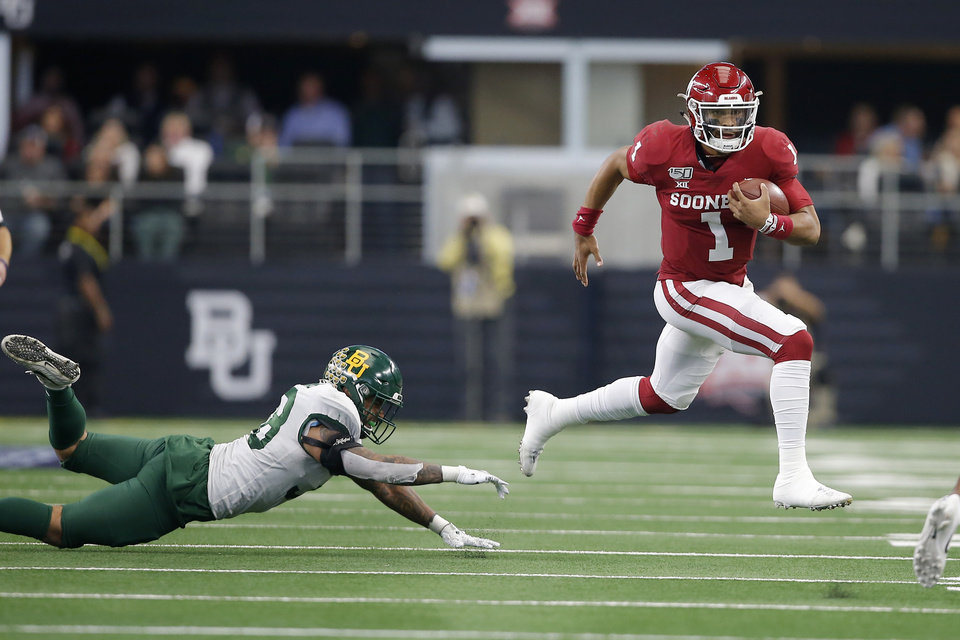 Photo - Oklahoma's Jalen Hurts (1) leaps past Baylor's Jordan Williams (38) during the Big 12 Championship Game between the University of Oklahoma Sooners (OU) and the Baylor University Bears at AT&T Stadium in Arlington, Texas, Saturday, Dec. 7, 2019. Oklahoma won 30-23. [Bryan Terry/The Oklahoman]