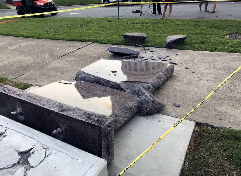 Photo - The new Ten Commandments monument outside the state Capitol in Little Rock, Ark., is blocked off Wednesday morning, June 28, 2017, after someone crashed into it with a vehicle, less than 24 hours after the privately funded monument was installed on the Capitol grounds. Authorities arrested a male suspect. (AP Photo/Jill Zeman Bleed)