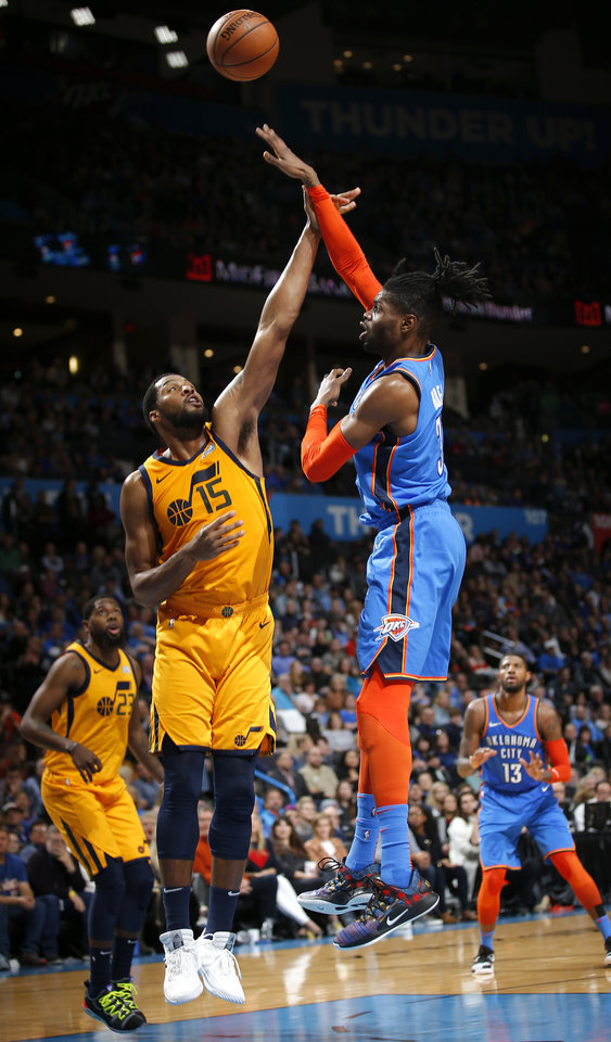 Photo - Oklahoma City's Nerlens Noel (3) shoots over Utah's Derrick Favors (15) during the NBA game between the Oklahoma City Thunder and the Utah Jazz at the Chesapeake Energy Arena, Friday, Feb. 22, 2019. Photo by Sarah Phipps, The Oklahoman