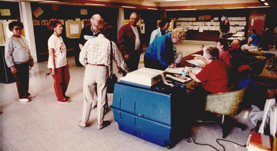 Photo - On Oct. 15, 1991, voters lined up at Hoover Fifth and Sixth-Year Center to cast their ballots on the HB 1017 issue. [Photo by David McDaniel, The Oklahoman Archives]
