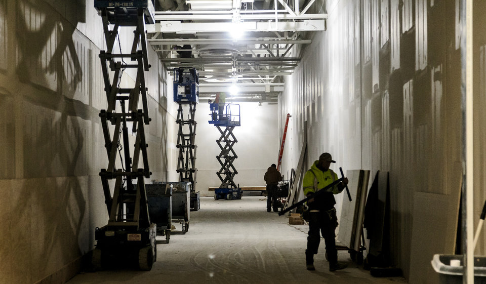 Photo -  Contractors at OKCWorks prepare space inside the plant for a coming tenant. [Photo by Chris Landsberger, The Oklahoman]