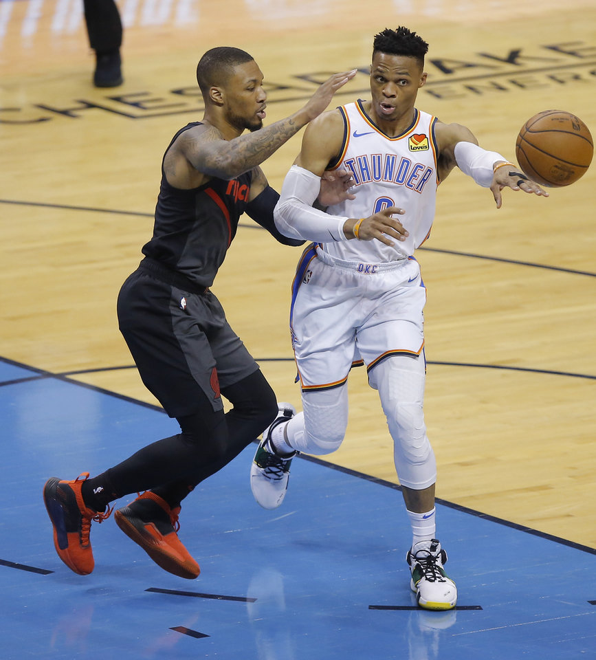 Photo - Oklahoma City's Russell Westbrook (0) passes the ball beside Portland's Damian Lillard (0) during Game 4 in the first round of the NBA playoffs between the Portland Trail Blazers and the Oklahoma City Thunder at Chesapeake Energy Arena in Oklahoma City, Sunday, April 21, 2019. Photo by Bryan Terry, The Oklahoman