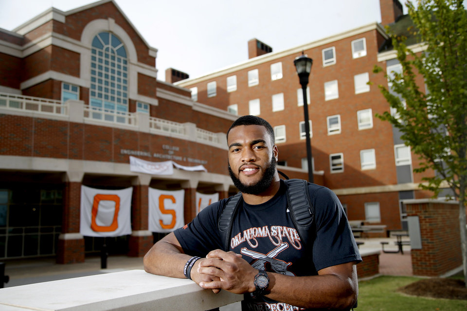 Photo -  Oklahoma State receiver Chris Lacy is a rarity — a major-college football player in his team's regular rotation and his university's engineering school. He is an industrial engineering and management major. [PHOTO BY BRYAN TERRY, THE OKLAHOMAN]