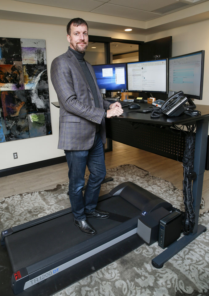 Photo -  Jason Trice, president and CEO of Jasco, is shown at the treadmill desk in his office. [Photo by Nate Billings, The Oklahoman]