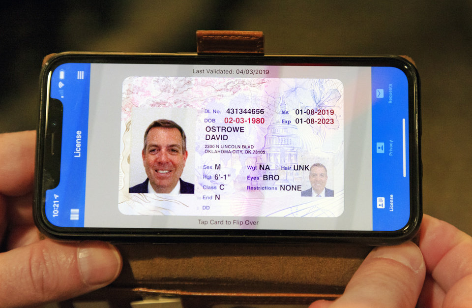 Photo -  The state is testing digital driver's licenses, such as this one shown during the planning meeting.
