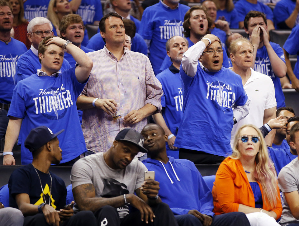 Photo - Fans react to a call during Game 5 of the first round series between the Oklahoma City Thunder and the Dallas Mavericks in the NBA playoffs at Chesapeake Energy Arena in Oklahoma City, Monday, April 25, 2016. The Thunder won 118-104. Photo by Nate Billings, The Oklahoman