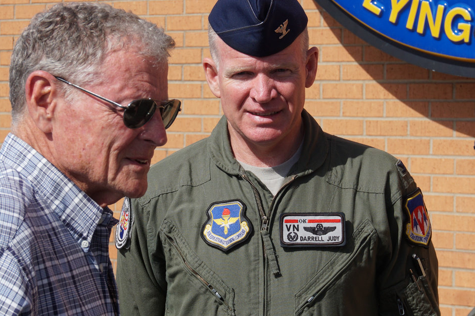 Photo -  U.S. Sen. Jim Inhofe speaks with Col. Darrell Judy during a tour of Vance Air Force Base in Enid. [Photo by Ben Felder, The Oklahoman]