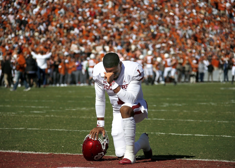 Photo - Oklahoma's Jalen Hurts (1) takes a knee before the Red River Showdown college football game between the University of Oklahoma Sooners (OU) and the Texas Longhorns (UT) at Cotton Bowl Stadium in Dallas, Saturday, Oct. 12, 2019. OU won 34-27. [Sarah Phipps/The Oklahoman]
