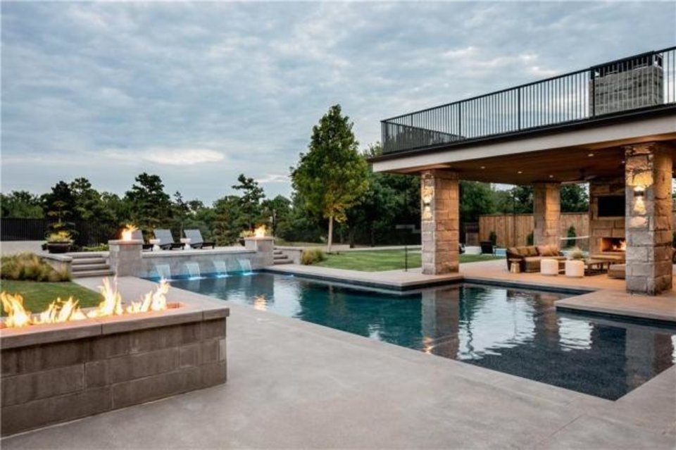 Photo -  Pool and outdoor living area at the Listing of the Week, 1303 Bedford Drive in Nichols Hills. [PHOTO PROVIDED]