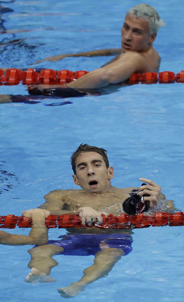 Photo - United States' Michael Phelps wins the gold medal in the men's 200-meter individual medley ahead of fifth placed United States' Ryan Lochte, top, during the swimming competitions at the 2016 Summer Olympics, Thursday, Aug. 11, 2016, in Rio de Janeiro, Brazil. (AP Photo/Natacha Pisarenko)