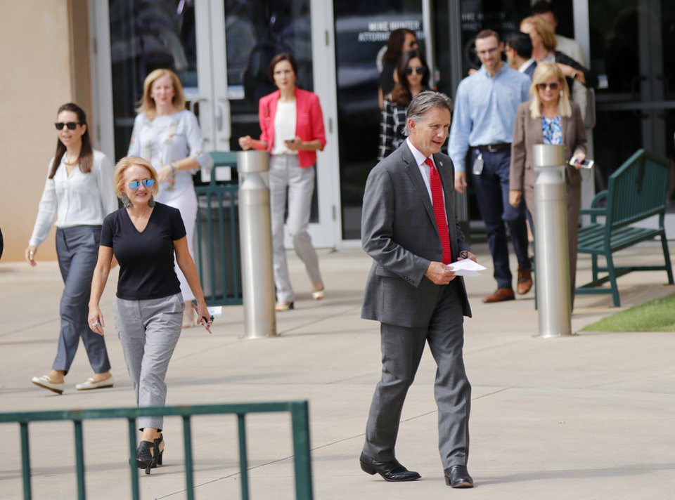 Photo - Mike Hunter comes out to speak about Gentner Drummond conceding in the Republican runoff for the Oklahoma Attorney General, and is followed by members of the AG office, outside of the Attorney General office Wednesday, August 29, 2018.  Photo by Doug Hoke, The Oklahoman