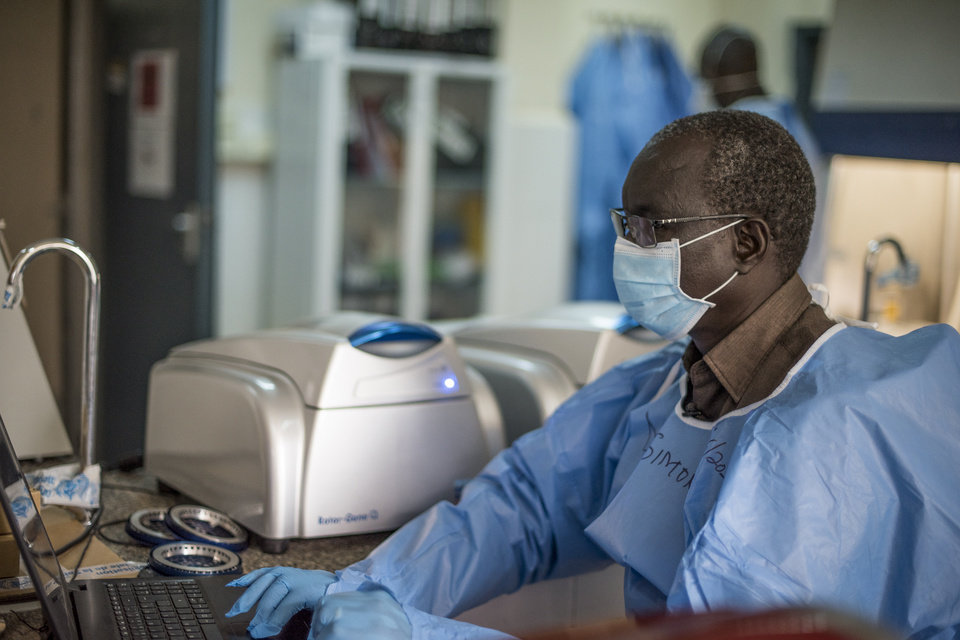 Photo -  In this photo taken Friday, June 19, 2020, laboratory supervisor Simon Deng Nyichar enters data for patient samples at the country's only laboratory that tests for the coronavirus in Juba, South Sudan. The United Nations says the country's outbreak is growing rapidly, with nearly 1,900 cases, including more than 50 health workers infected, and at the only laboratory in the country that tests for the virus a team of 16 works up to 16-hour days slogging through a backlog of more than 5,000 tests. (AP Photo/Charles Atiki Lomodong)