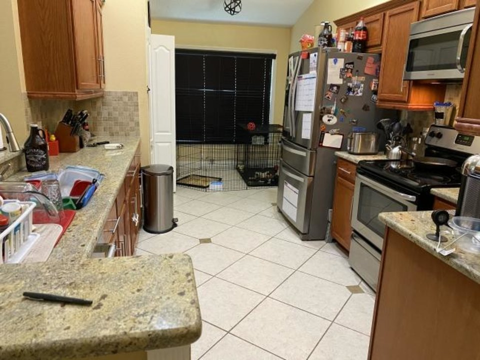 "Photo -  ""How did we live so messy before?"" these homeowners asked after their four-bedroom house was decluttered and staged to sell. Here is a before shot of the kitchen. [Provided/Tara Carey]"
