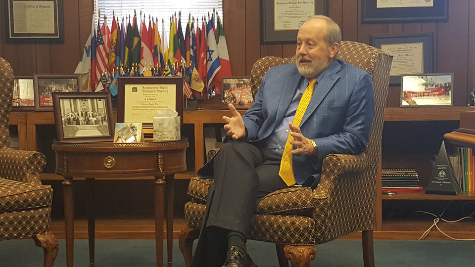 Photo -  In his office at Oklahoma Baptist University, the private Christian school's president, David Whitlock, discusses his decision to have an image of the Confederate flag removed from a stained glass window in the university's historic Raley Chapel. [Photo by Carla Hinton, The Oklahoman]