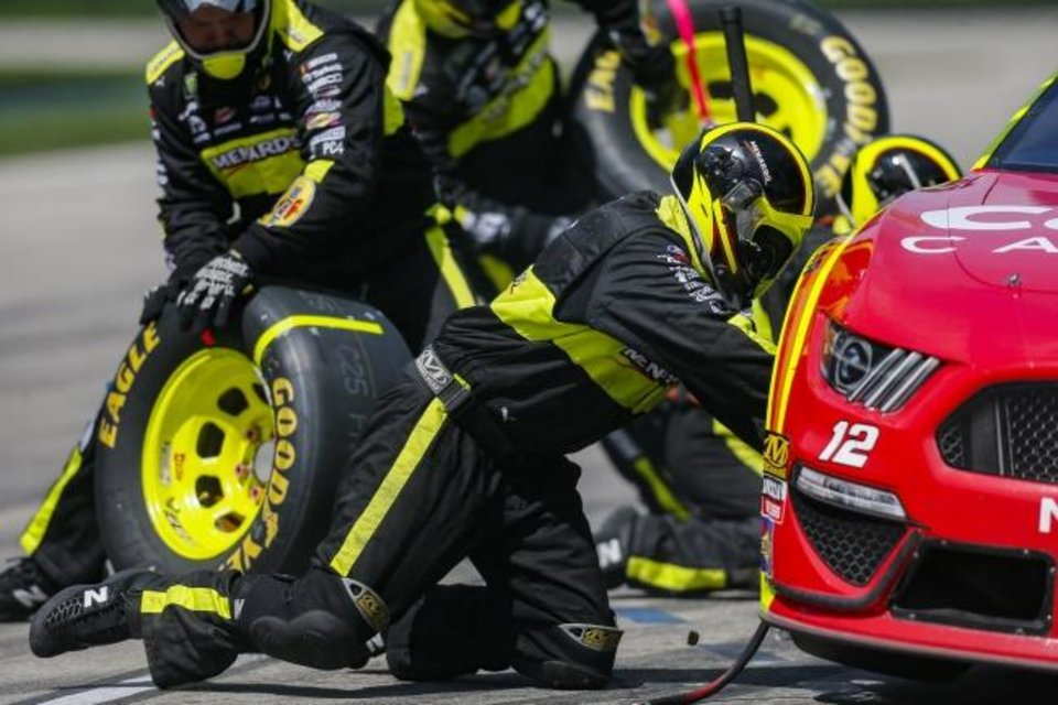 Photo -  Ryan Blaney's pit crew work on his car during a Sunday's race at Texas Motor Speedway in Fort Worth. [AP Photo/Brandon Wade]