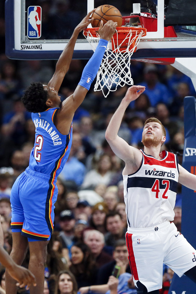 Photo - Oklahoma City's Shai Gilgeous-Alexander (2) dunks the ball next to Washington's Davis Bertans (42) in the fourth quarter during an NBA basketball game between the Oklahoma City Thunder and the Washington Wizards at Chesapeake Energy Arena in Oklahoma City, Friday, Oct. 25, 2019. The Wizards won 97-85. [Nate Billings/The Oklahoman]