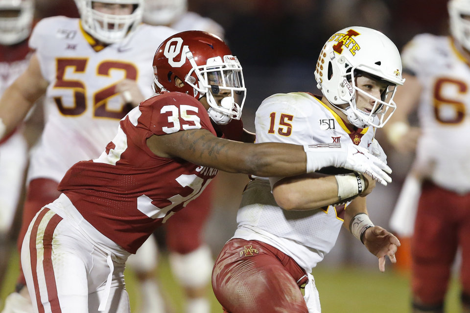 Photo - Oklahoma's Nik Bonitto (35) tries to bring down Iowa State's Brock Purdy (15) during an NCAA football game between the University of Oklahoma Sooners (OU) and the Iowa State University Cyclones at Gaylord Family-Oklahoma Memorial Stadium in Norman, Okla., Saturday, Nov. 9, 2019. [Bryan Terry/The Oklahoman]