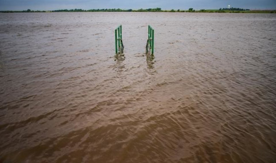 Photo - High waters from the recent flooding rains submerge a dock, and have closed down Lake El Reno in El Reno, Okla. on Friday, May 24, 2019.  [Chris Landsberger/The Oklahoman]