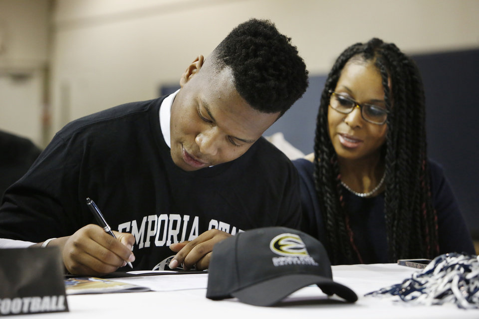 Photo - Casady High School football athlete Gary Woods signing his leter of intent during signing day ceremonies at Casady High School in Oklahoma City Wednesday, Feb. 4, 2015. Photo by Paul B. Southerland, The Oklahoman