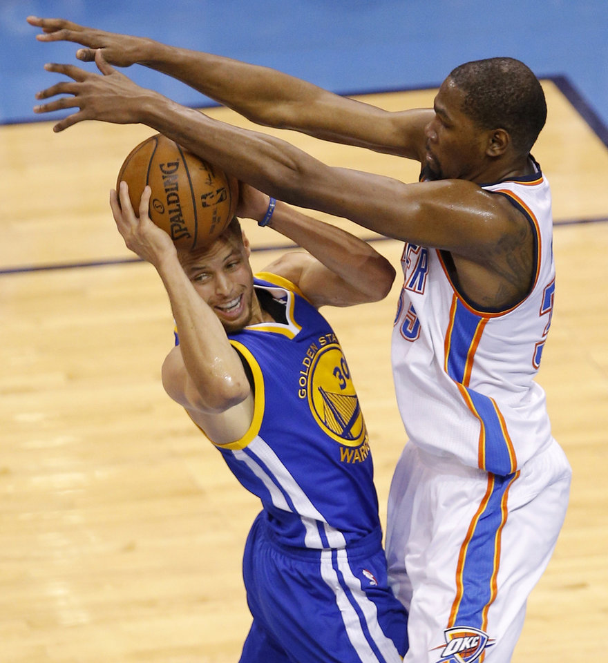 Photo - Oklahoma City's Kevin Durant (35) defends Golden State's Stephen Curry (30) during Game 6 of the Western Conference finals in the NBA playoffs between the Oklahoma City Thunder and the Golden State Warriors at Chesapeake Energy Arena in Oklahoma City, Saturday, May 28, 2016. Photo by Bryan Terry, The Oklahoman