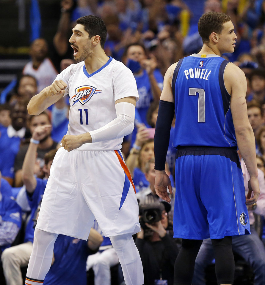 Photo - Oklahoma City's Enes Kanter (11) reacts next to Dallas' Dwight Powell (7) after making a basket in the third quarter during Game 5 of the first round series between the Oklahoma City Thunder and the Dallas Mavericks in the NBA playoffs at Chesapeake Energy Arena in Oklahoma City, Monday, April 25, 2016. The Thunder won 118-104. Photo by Nate Billings, The Oklahoman