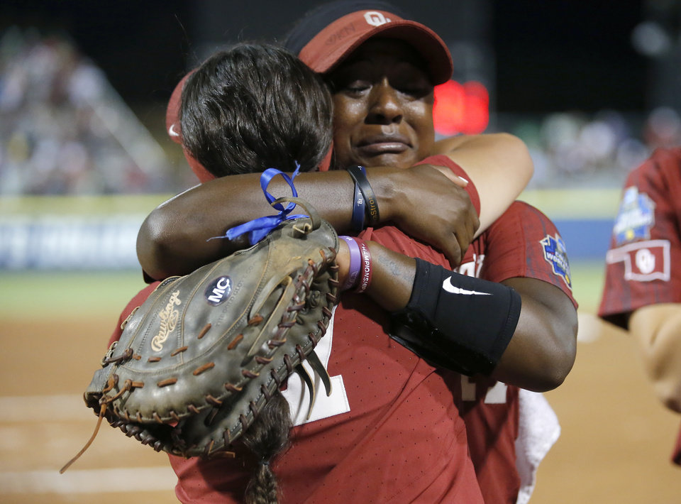 Photo - Oklahoma's Shay Knighten (17) hugs Oklahoma's Alexa Schultz (7) following the second NCAA softball game in the championship series of the Women's College World Series between Oklahoma and UCLA at USA Softball Hall of Fame Stadium in Oklahoma City, Tuesday, June 4, 2019. [Sarah Phipps/The Oklahoman]