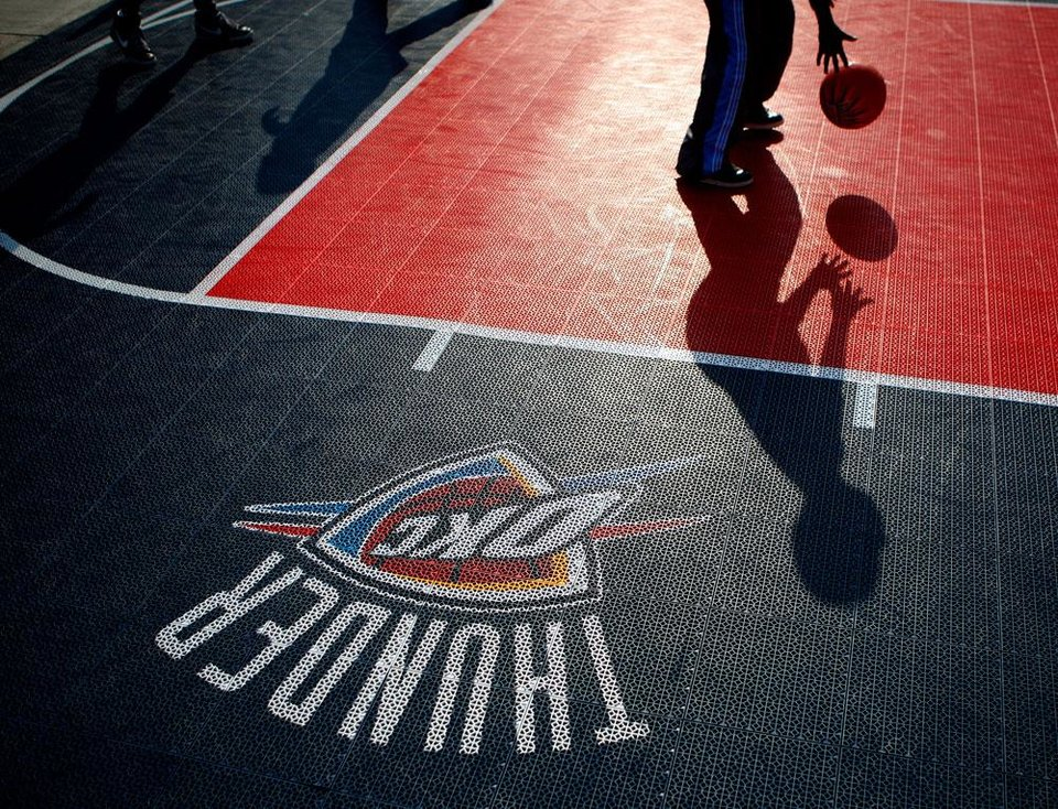 Photo -  Fans play basketball on a court outside the arena before the NBA basketball game between the Oklahoma City Thunder and the Los Angeles Clippers at Chesapeake Energy Arena in Oklahoma City, Wednesday, April 11, 2012. Photo by Bryan Terry, The Oklahoman