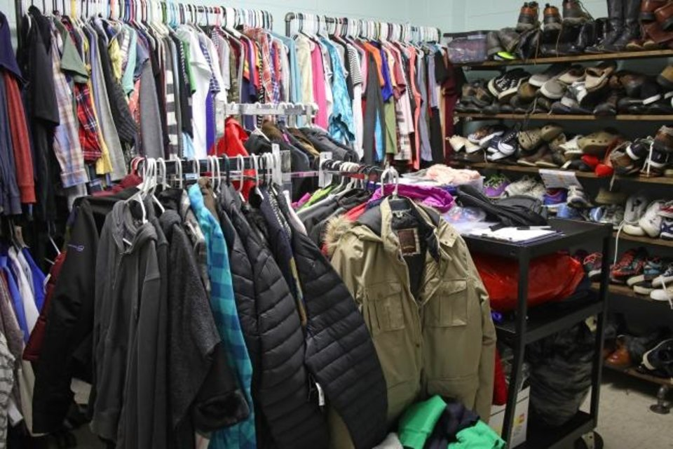 Photo -  The Sisu Youth Services clothing room is seen on Feb. 26.  [Doug Hoke/The Oklahoman]