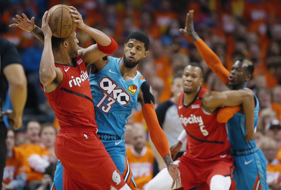 Photo - Oklahoma City's Paul George (13) defends Portland's Evan Turner (1) during Game 3 in the first round of the NBA playoffs between the Portland Trail Blazers and the Oklahoma City Thunder at Chesapeake Energy Arena in Oklahoma City, Friday, April 19, 2019. Photo by Bryan Terry, The Oklahoman