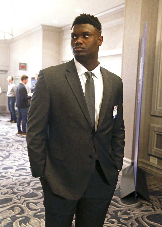 Photo - Duke's Zion Williamson arrives for the NBA basketball draft lottery Tuesday, May 14, 2019, in Chicago. (AP Photo/Nuccio DiNuzzo)