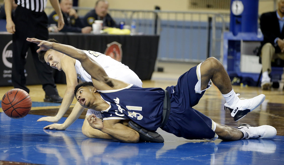 Photo - Heritage Hall's Phillip Smitherman, right, dives for the ball beside Broken Bow's Kyle Park during a Class 4A state tournament basketball game between Heritage Hall and Broken Bow High School in Jim Norick Arena at State Fair Park in Oklahoma City, Thursday, March 7, 2019. Photo by Bryan Terry, The Oklahoman